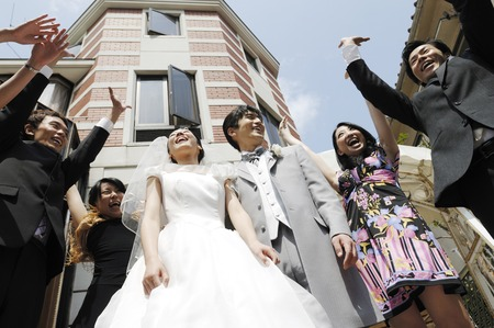 Bride and groom to receive the blessing of friends