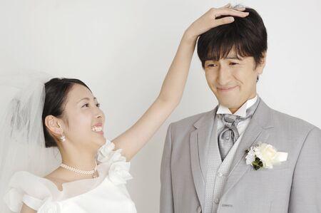 stroking: Bride stroking the grooms head