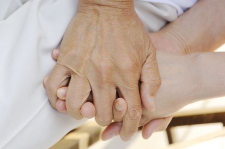 fostering: Old man hands Stock Photo