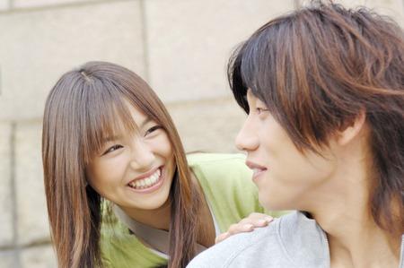 postpone: College student couples to postpone the eye Stock Photo