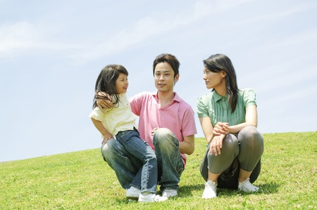 Family to chat sitting on hill