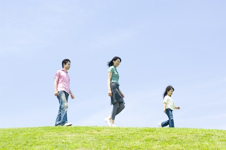 Family walking side by side up the hill