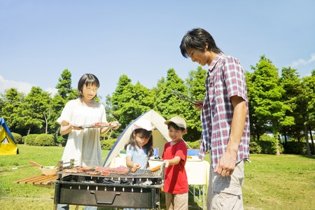 family asia: Families enjoy the BBQ