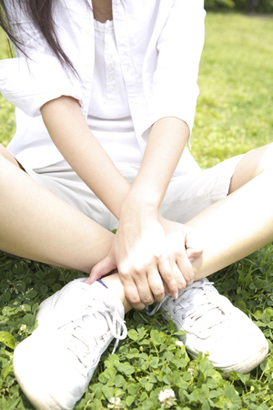 lacking: Women lacking the Cross-legged in the park Stock Photo
