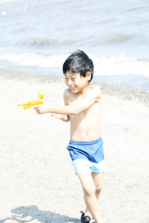 water gun: Boy playing with water gun