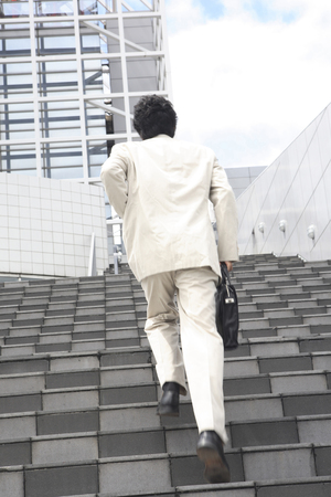 go up: Businessman go up the stairs