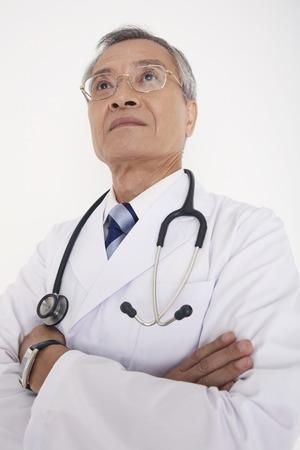 fold ones arms: Male doctor Arms Crossed