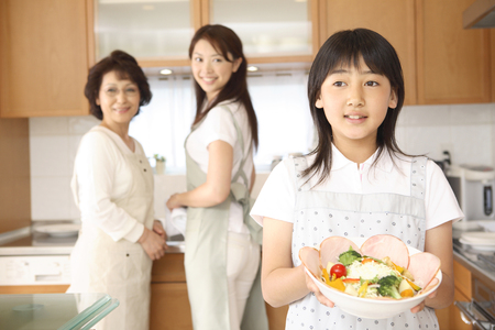 japanese cooking: Three generation family Stock Photo