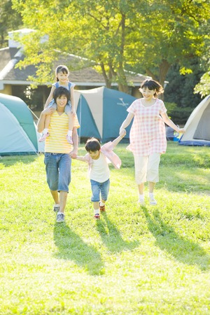 momma: Family walking the campground hand in hand Stock Photo