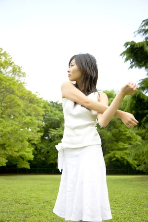 salubrious: Woman to the stretch in the park Stock Photo