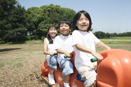 playground equipment: Children playing in the playground equipment Stock Photo