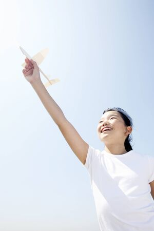 tries: Girl tries to Fly a paper airplane