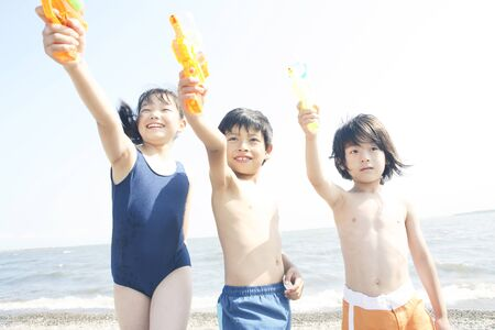 water gun: Children playing with water gun
