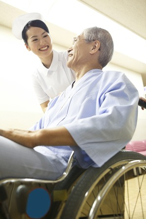asian old man: The patients nurse and wheelchair Stock Photo