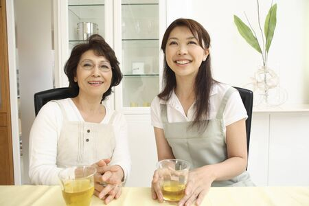 senior adults: Daughter-in-law and mother-in-law of smile