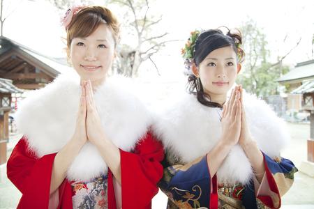 women praying: Two women praying to furisode kimono