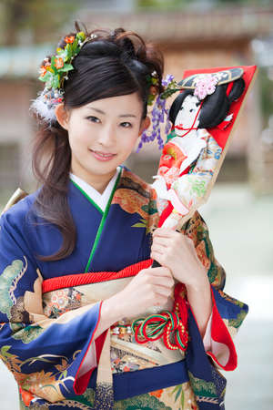 battledore: Woman of kimono wearing smiling with a battledore