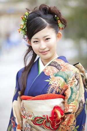 early 20s: Furisode kimono in cheek smile woman
