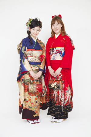 2 women smiling in a long-sleeved kimono figure