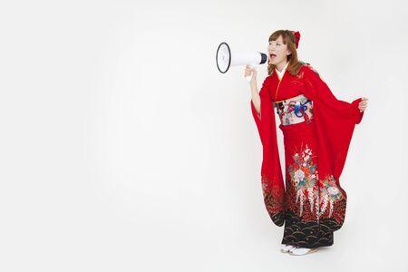 early 20s: Women kimono figure with a loudspeaker