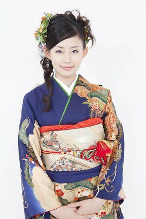early 20s: Woman smiling in furisode kimono Stock Photo