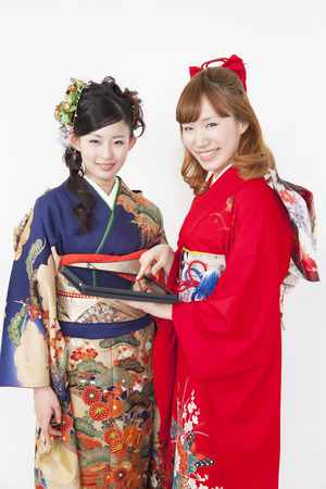 early 20s: Women kimono figure touch the tablet PC