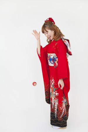 early 20s: Women kimono figure that the yo-yo Stock Photo
