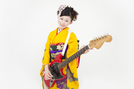 new age music: Women kimono figure with a guitar