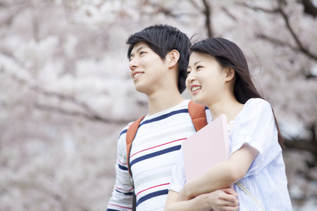 Couple smiling under the cherry tree