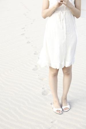 sandy feet: Feet of women who walk the sandy beach