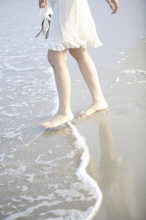 one piece dress: Feet of women who are in the beach