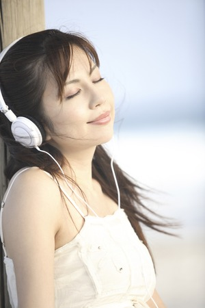 one piece dress: Woman listening to music