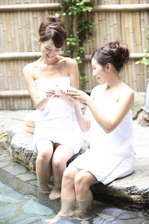openair: Women soak my feet only to open-air bath Stock Photo