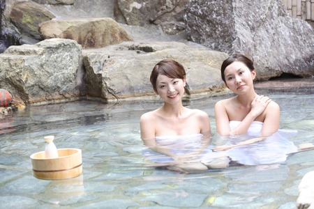 Woman relaxing in the hot spring Stock Photo