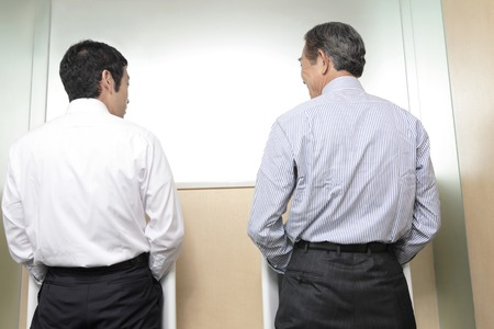 superiors: Superiors and subordinates to talk in the toilet Stock Photo
