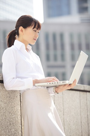 personal computer: Career woman operating a personal computer Stock Photo