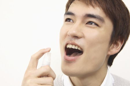 bad breath: Men who the bad breath spray Stock Photo
