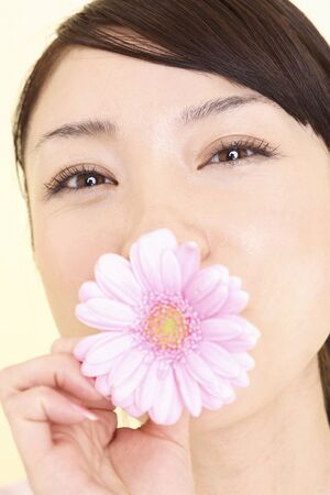 sucks: Woman who sucks the flowers to mouth