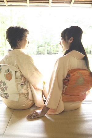 doings: Two kimono women sit on the veranda Stock Photo
