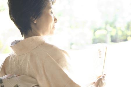 doings: Kimono woman shall be sought by a sense Stock Photo