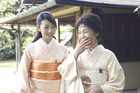 doings: Two kimono women to walk in the garden Stock Photo