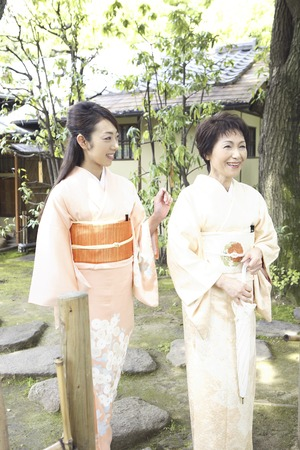 Two kimono women to walk in the garden Stock Photo