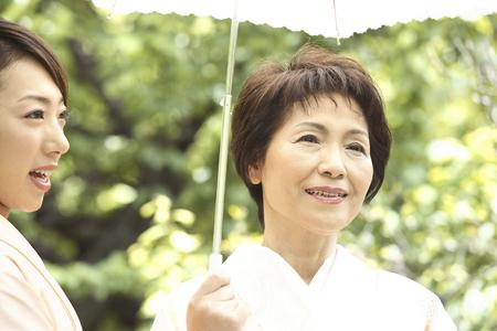 doings: Two kimono women who parasols Stock Photo