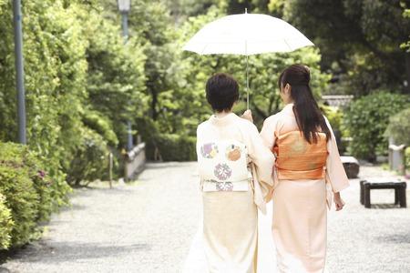 Rear View of two kimono women with parasols Stock Photo