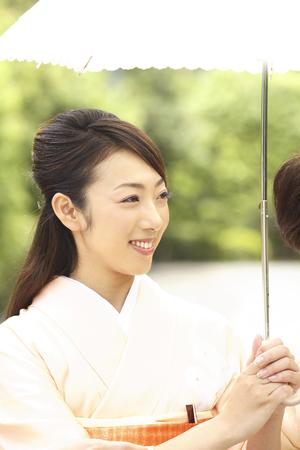 parasols: Two kimono women who parasols Stock Photo