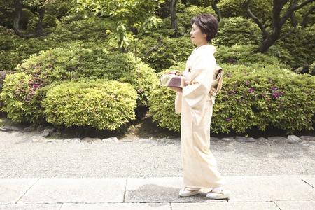 doings: Kimono women who go out with a gift Stock Photo