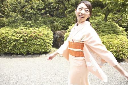 doings: Kimono woman to walk in the garden Stock Photo