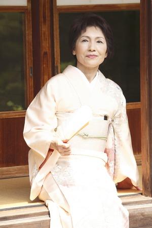 doings: Kimono women fan  with sitting on the veranda