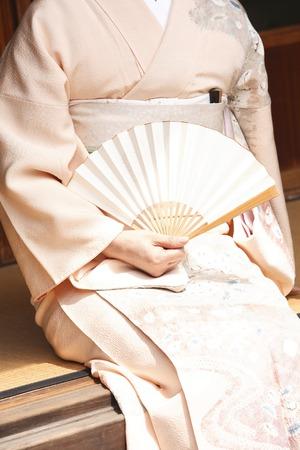 Kimono woman image with a fan Stock Photo