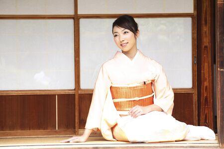 Kimono Lady standing on the veranda